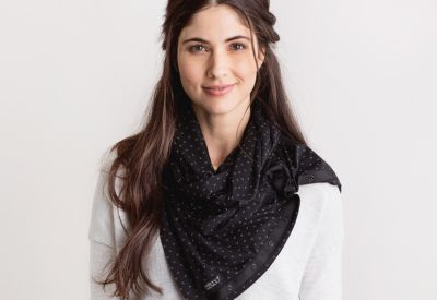 model wearing floral dot nursing scarf from nuroo