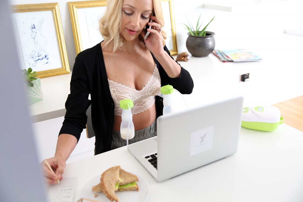 woman pumps in dairy fairy bra while working